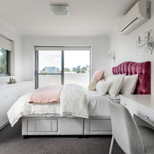 Photo of a small contemporary bedroom in Perth with white walls, carpet and grey floor.