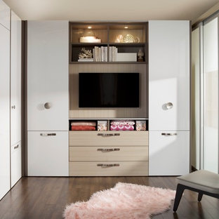 Inspiration for a small modern loft-style dark wood floor bedroom remodel in New York with white walls and no fireplace