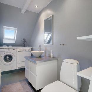 Immagine di una lavanderia scandinava di medie dimensioni con ante lisce, ante bianche, pareti grigie, pavimento in linoleum e pavimento grigio