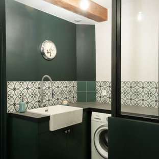 This is an example of a large industrial utility room in Lyon with a single-bowl sink, tile countertops, green walls, ceramic flooring, a side by side washer and dryer, grey floors and grey worktops.