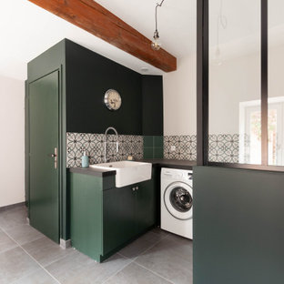 Design ideas for a large industrial utility room in Lyon with a single-bowl sink, tile benchtops, green walls, ceramic floors, a side-by-side washer and dryer, grey floor and grey benchtop.