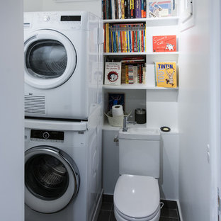 Inspiration for a small contemporary single-wall ceramic floor utility room remodel in Paris with open cabinets, white cabinets, white walls and a stacked washer/dryer