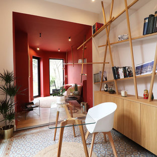 Photo of a medium sized contemporary study in Lille with pink walls, terracotta flooring, a freestanding desk and blue floors.