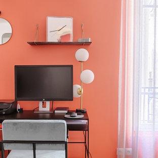 Idéer för ett modernt arbetsrum, med orange väggar