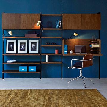 La bibliothèque et ses contrastes bois et métal