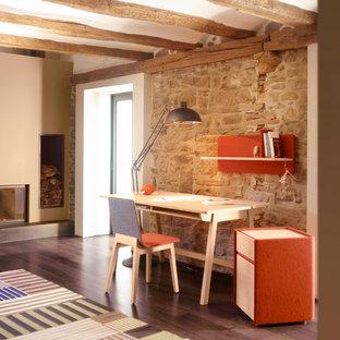Réalisation d'un bureau design de taille moyenne avec un mur beige, un sol en bois foncé, une cheminée standard et un bureau indépendant.