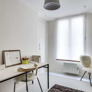 Example of a mid-sized trendy freestanding desk study room design in Paris with white walls