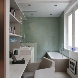 Exemple d'un petit bureau tendance avec un mur beige, béton au sol et un bureau intégré.