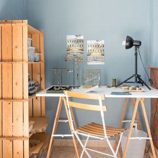 This is an example of a country craft room in Montpellier with blue walls, a freestanding desk and pink floors.