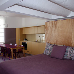 Idee per una piccola camera da letto stile loft design con pareti bianche