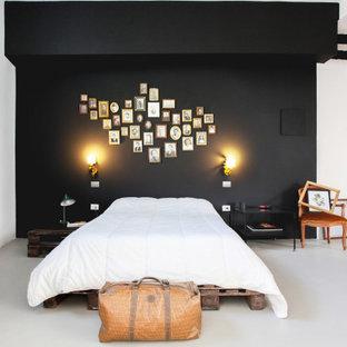 Idee per una camera da letto minimal con pareti nere, pavimento in cemento e pavimento bianco
