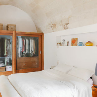 This is an example of a mediterranean master bedroom in Other with terra-cotta floors.