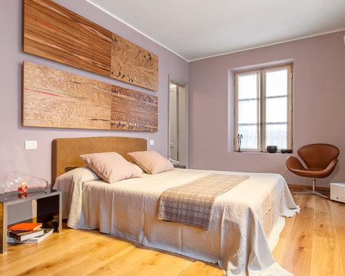 Camera da letto con parquet chiaro e pareti rosa - Foto e Idee per ...