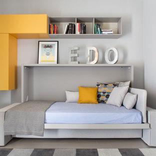 Esempio di una camera degli ospiti contemporanea di medie dimensioni con pareti grigie e pavimento in gres porcellanato