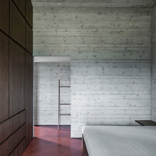 Bedroom - large contemporary master concrete floor and red floor bedroom idea in Other