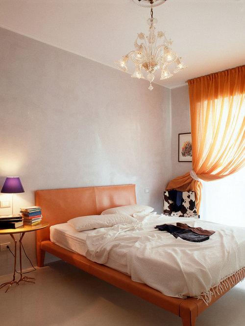 Camera da letto contemporanea con pareti grigie - Foto e Idee per ...