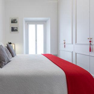 Esempio di una camera da letto minimal con pareti bianche