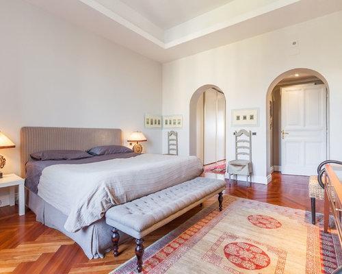 Camera da letto eclettica con pareti grigie - Foto e Idee per Arredare