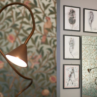 Inspiration for a large 1960s master terra-cotta tile, red floor, wallpaper ceiling and wallpaper bedroom remodel in Florence with green walls