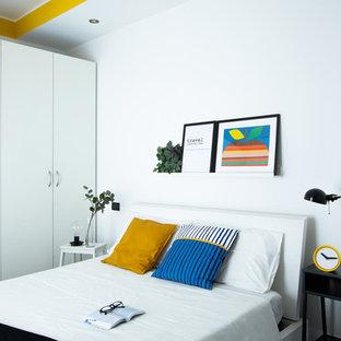 Idee per una camera da letto contemporanea con pareti bianche