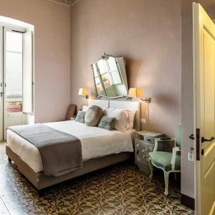 Bedroom - mid-sized traditional guest terra-cotta tile, brown floor, vaulted ceiling and wainscoting bedroom idea in Cagliari with beige walls