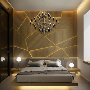 На фото: с высоким бюджетом маленькие хозяйские спальни в стиле модернизм с коричневыми стенами, полом из известняка и серым полом