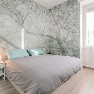 Mid-sized trendy master light wood floor bedroom photo in Rome with multicolored walls