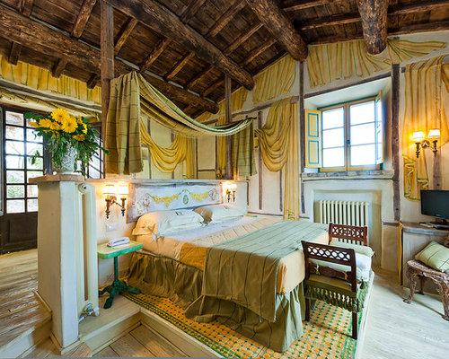Foto e idee per camere da letto camera da letto in montagna - Camino in camera da letto ...