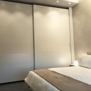 Modelo de dormitorio tipo loft, moderno, de tamaño medio, sin chimenea, con paredes beige, suelo de linóleo y suelo gris