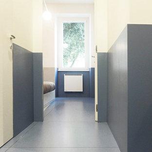 Foto di una camera matrimoniale minimal di medie dimensioni con pareti bianche, pavimento in gres porcellanato, nessun camino e pavimento turchese