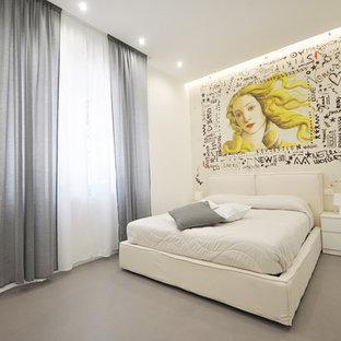 Immagine di una camera matrimoniale contemporanea di medie dimensioni con pareti bianche, pavimento in cemento, nessun camino e pavimento grigio
