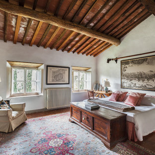 Design ideas for a large country master bedroom in Florence with white walls, terra-cotta floors and red floor.