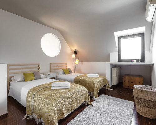 Camera da letto con parquet scuro - Foto e Idee per Arredare