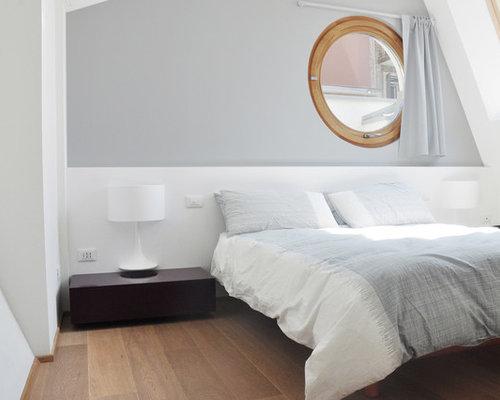 Camera da letto moderna con pareti grigie foto e idee per arredare - Foto di camere da letto moderne ...