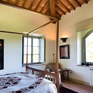 Foto de dormitorio principal y panelado, de estilo de casa de campo, pequeño, panelado, con paredes blancas, suelo de ladrillo, suelo naranja y panelado