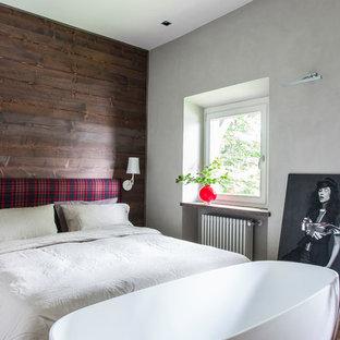 Immagine di una camera matrimoniale country di medie dimensioni con pareti multicolore e nessun camino