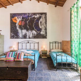 Bedroom - large eclectic guest slate floor bedroom idea in Catania-Palermo with white walls