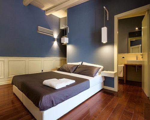 Camera da letto con pareti blu foto idee arredamento - Pareti blu camera da letto ...