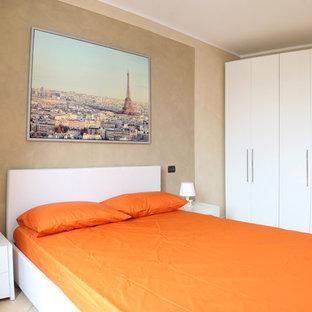 Photo of a medium sized modern master bedroom in Milan.
