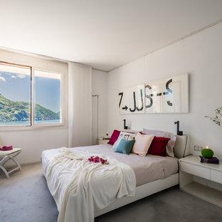 Idee per una camera degli ospiti design con pareti bianche, moquette e pavimento grigio