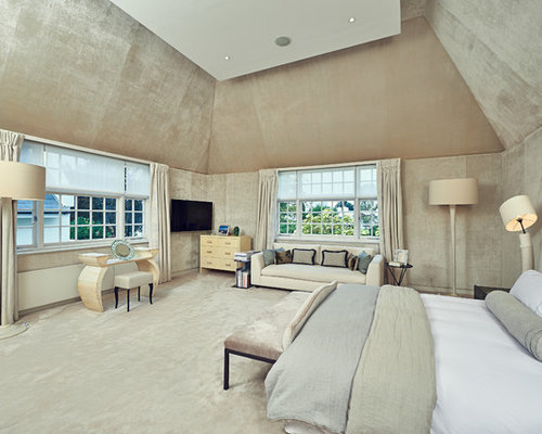 Traditional Bedroom Designs photo of a traditional master bedroom in london with white walls Classic Bedroom In Bari With Beige Walls Carpet And No Fireplace