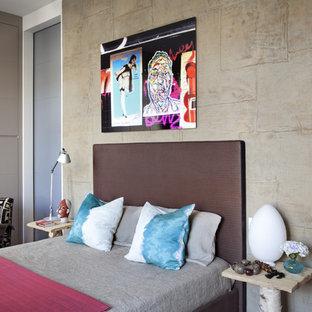 Foto di una camera da letto bohémian con pareti grigie