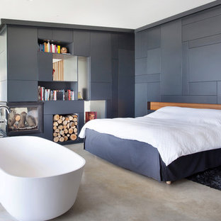 Design ideas for an expansive industrial bedroom in Florence with marble floors.