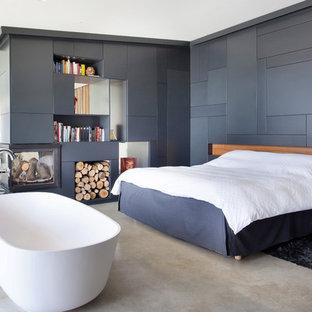 Idee per un'ampia camera da letto industriale con pavimento in marmo