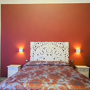 Inspiration for an asian master porcelain floor and gray floor bedroom remodel in Other with red walls