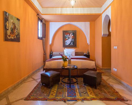 Camera degli ospiti con pareti arancioni - Foto e Idee per Arredare