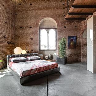 Chambre avec un mur rouge et béton au sol : Photos et idées déco de ...