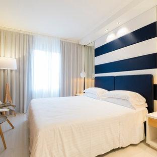 На фото: хозяйская спальня среднего размера в современном стиле с полом из керамогранита, бежевыми стенами и бежевым полом с