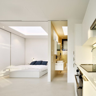 Photo of a modern master bedroom in Other with white walls and porcelain floors.