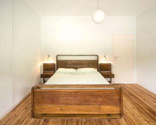 Camera da letto moderna con parquet scuro foto e idee - Foto camera da letto moderna ...